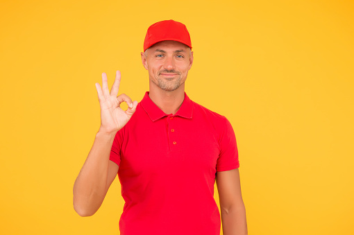 506662064 istock photo Free services. Freight transportation. Perfect delivery. Delivery man yellow background. Express delivery courier service. Parcel post package. 1272366055