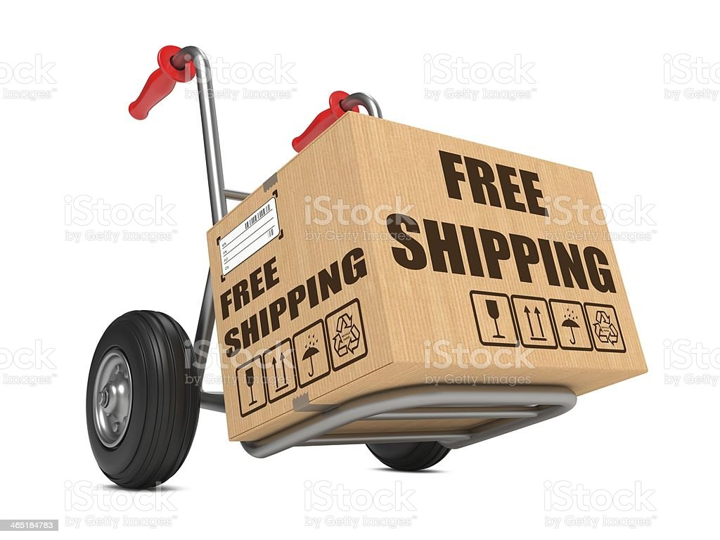 Free Shipping - Cardboard Box on Hand Truck. royalty-free stock photo