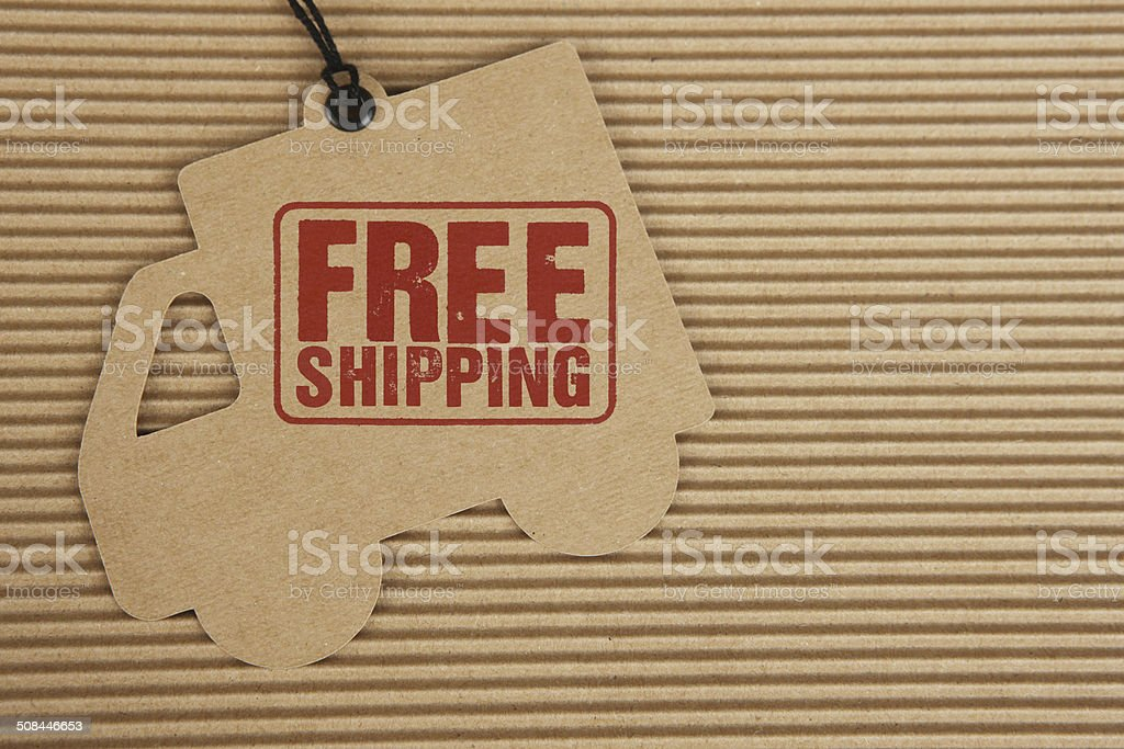 Free Shipping on Delivery Truck Tag on Corrugated Cardboard stock photo