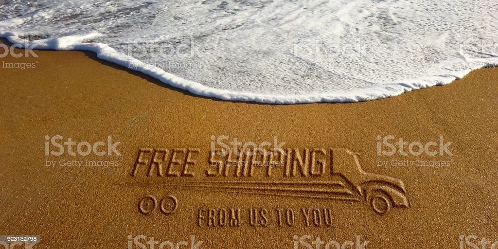 Free Shipping Text and Truck in the Beach Photo Image stock photo