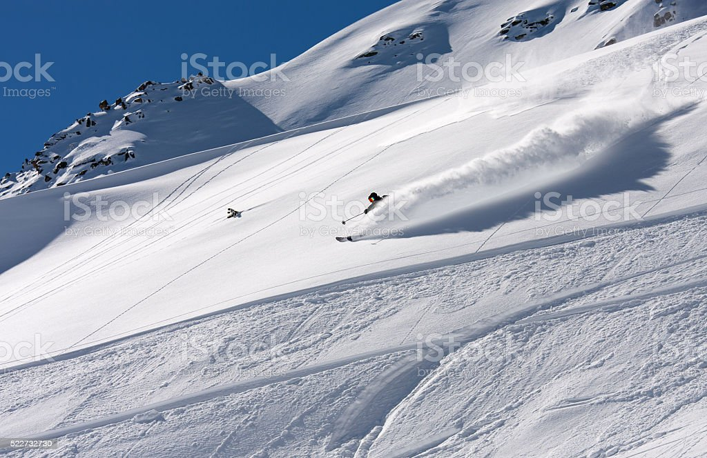 Free skier making a beautiful turn in the deep powder stock photo