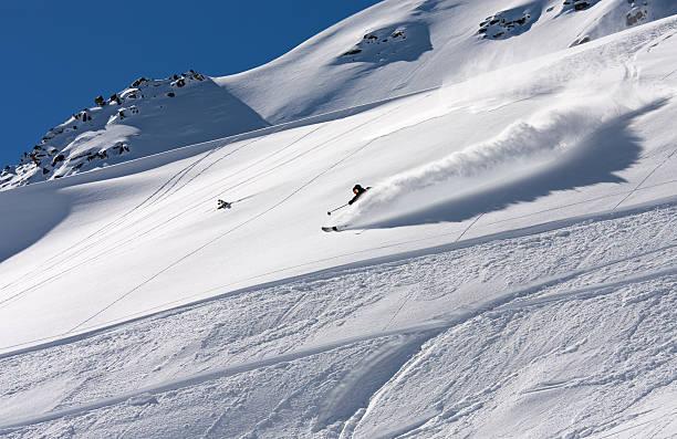 Free skier making a beautiful turn in the deep powder stock photo