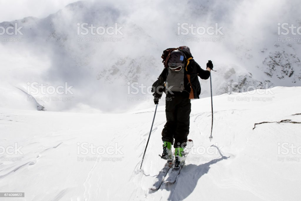 Free skier touring in the high mountain royalty-free stock photo
