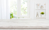 istock Free space table top background on blurred kitchen window interior 1221338074