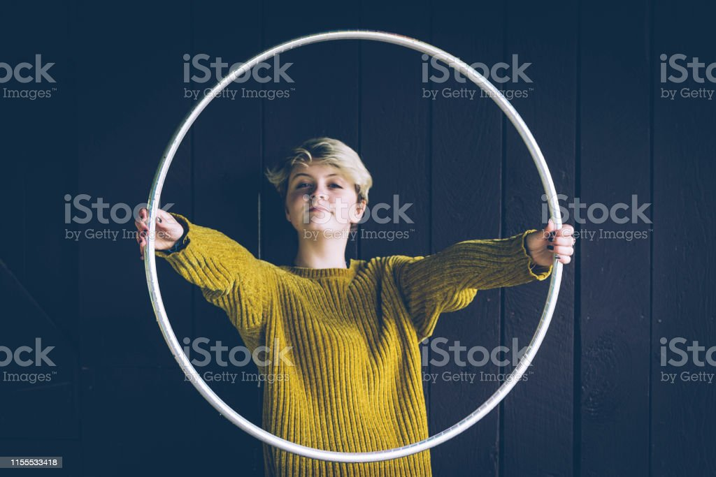 Free Spirit Female Seeking Solitude in the Forest Carrying Hula Hoop - Royalty-free Exercise Class Stock Photo