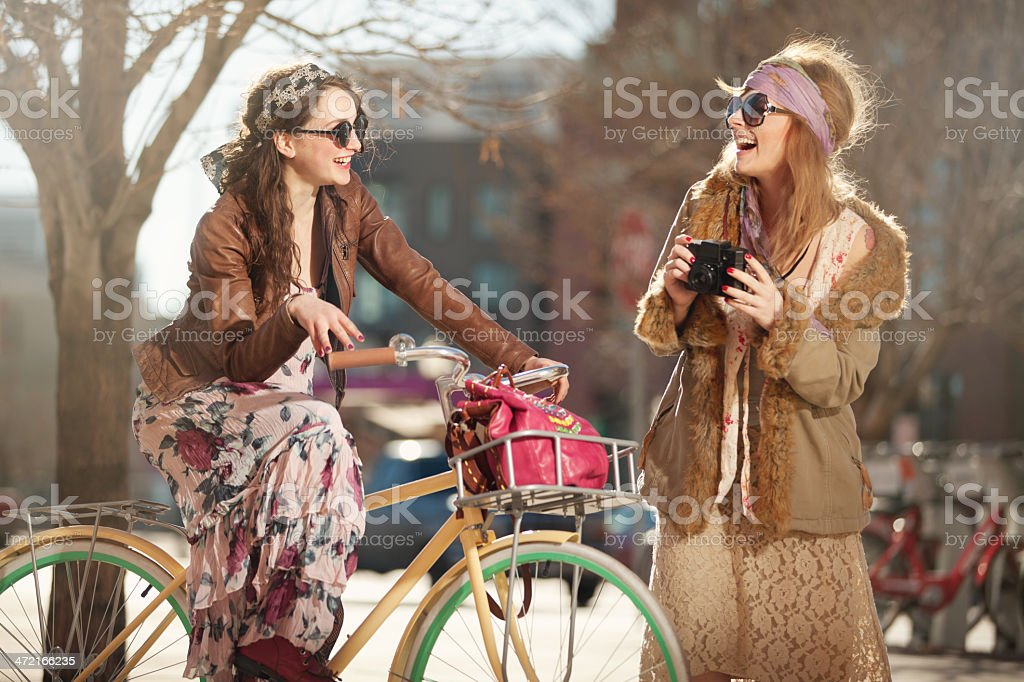 Free Spirit Girls Out in the Neighborhood with a Bicycle stock photo