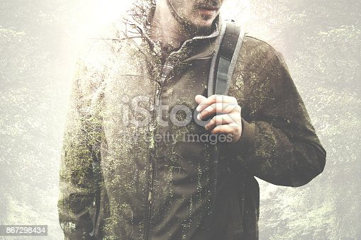 istock free spirit hiker in the forest double exposure 867298434