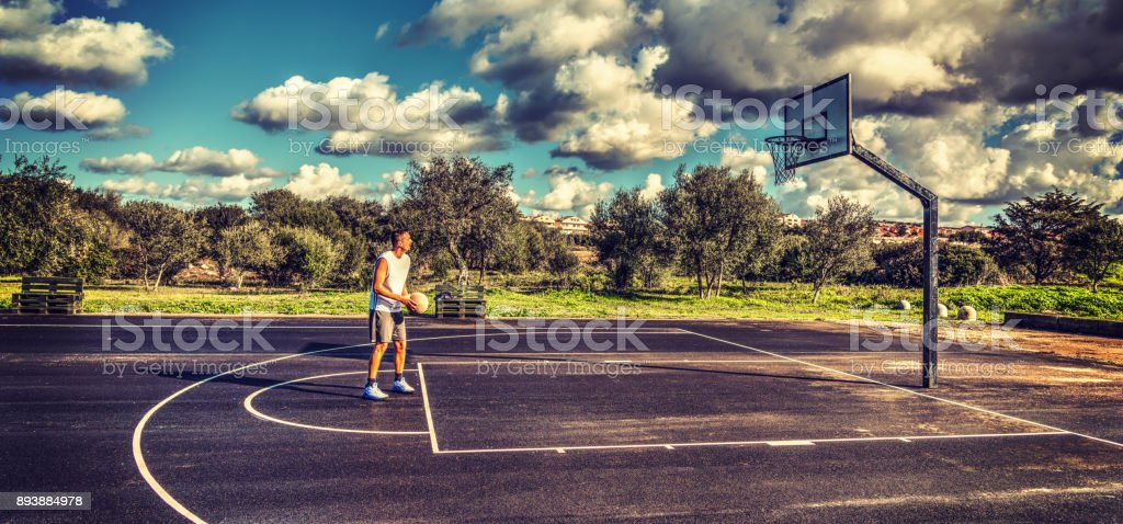 Free throw practice in a playground stock photo