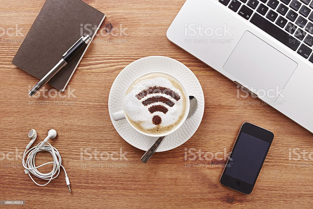 Free wifi area sign on a latte coffee stock photo