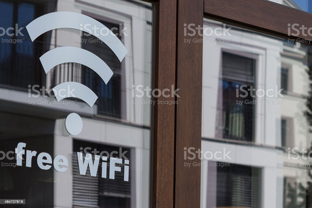 free wifi symbol - wireless internet icon on shop window stock photo