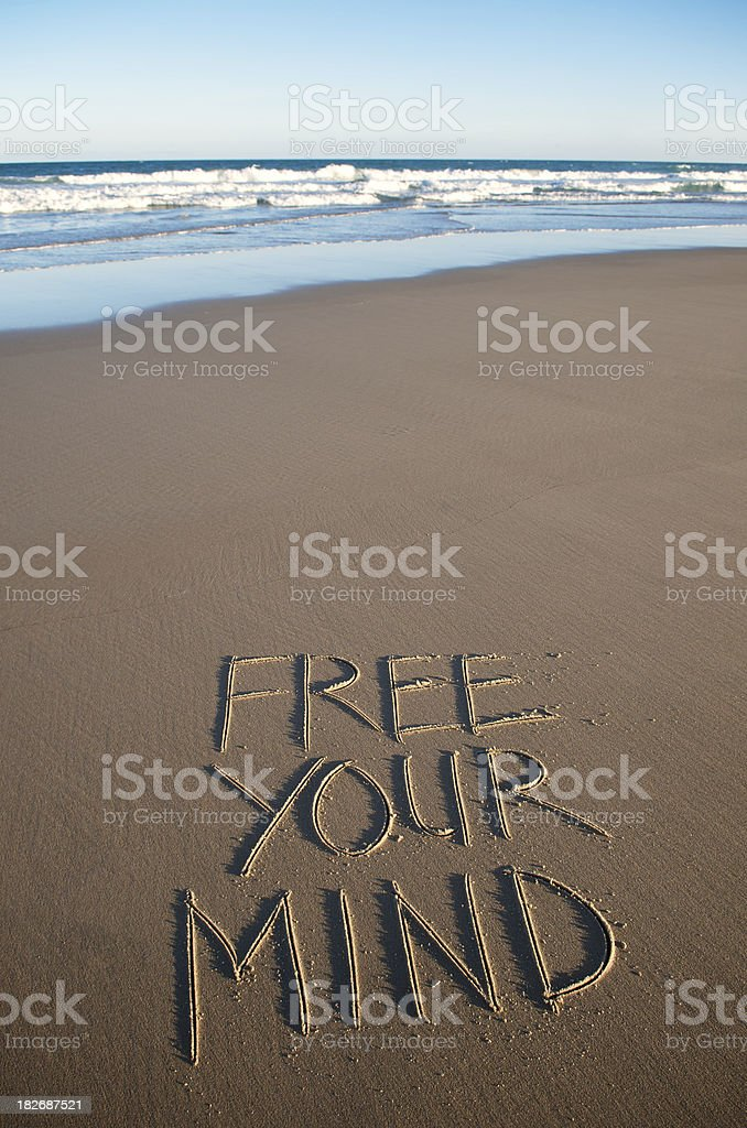 Free Your Mind Inspiration Message Handwritten on Empty Sand Beach royalty-free stock photo