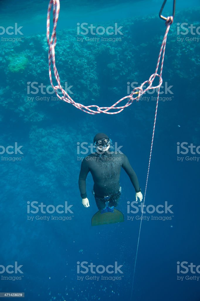 Freediver ascending from the deep stock photo