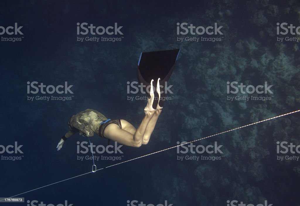 Freediver goes down by line royalty-free stock photo