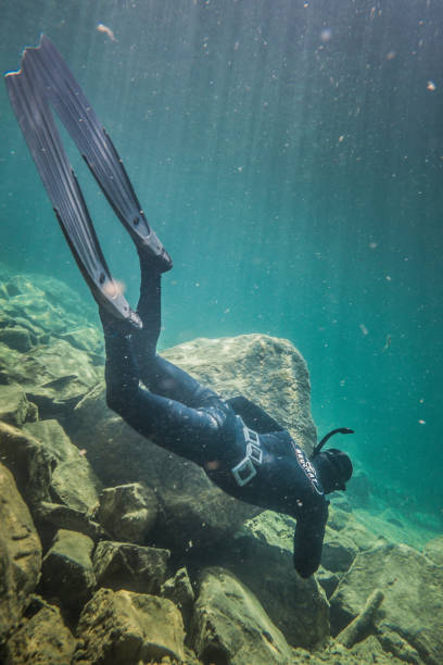 freediver letting hiself go with the strong current of the bonaventure river - deviate stock pictures, royalty-free photos & images