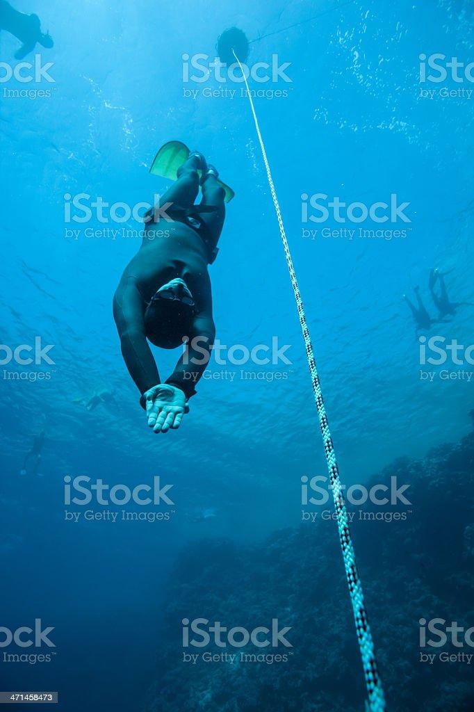 Freediver training in the ocean stock photo