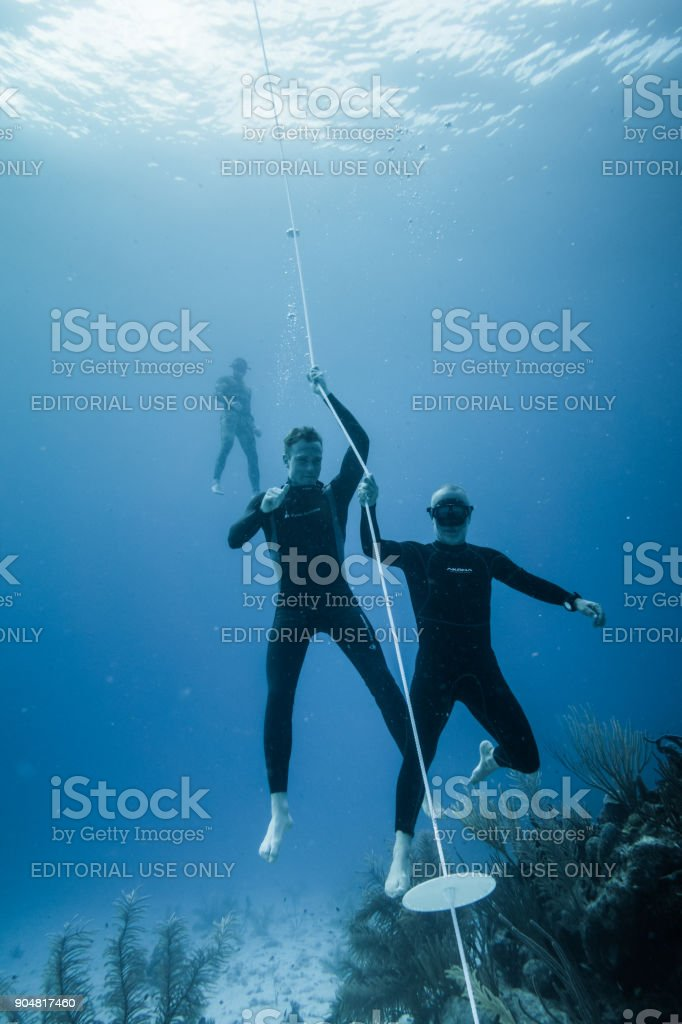 ISLAND, Colombia _ Circa March 2017. Freedivers at the Bottom of the...