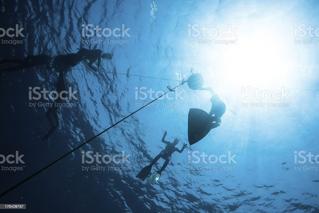Freedivers preparing to descent royalty-free stock photo