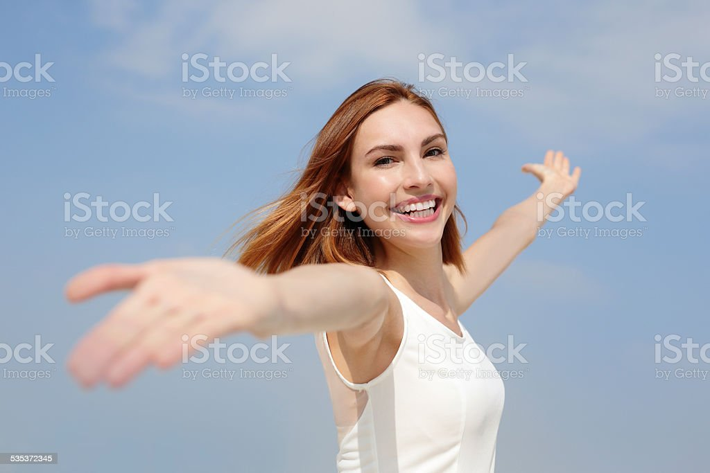 Freedom and Carefree woman stock photo