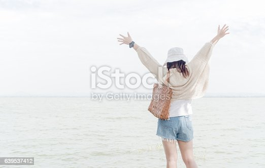 istock Freedom and happiness woman at dam with soft light. 639537412