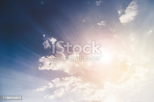 Cloud and bright sunbeams on a blue sky