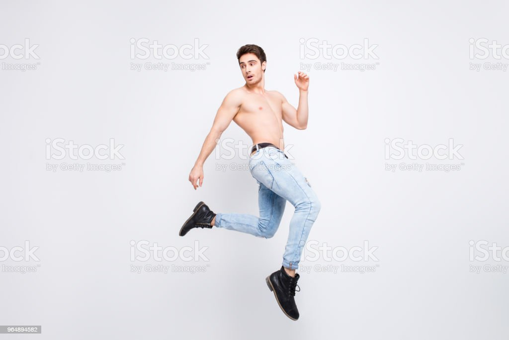 Freedom athlete turn boots shoes vogue modern model advertising concept. Full-length full-size portrait of attractive powerful handsome guy jumping up isolated on gray background copy-space royalty-free stock photo