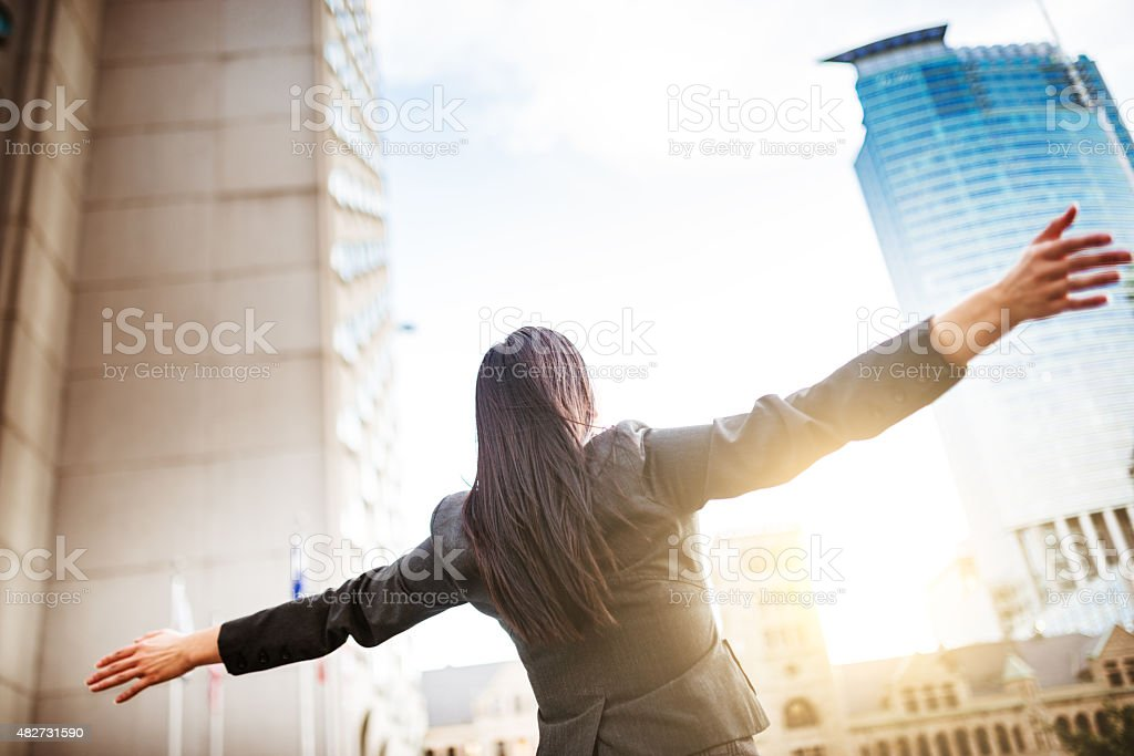 freedom business woman on the city stock photo