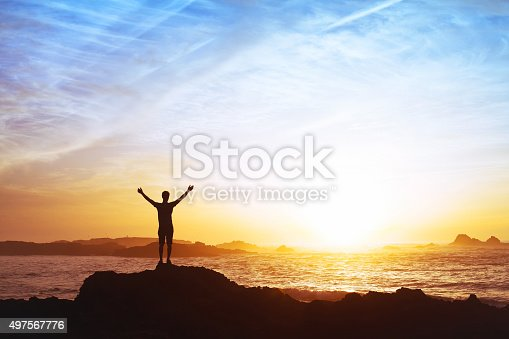 istock freedom concept, man with raised hands, silhouette 497567776