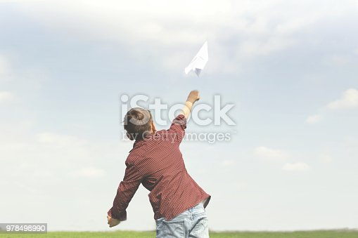 istock freedom concept with little boy throwing a paper plane in the sky 978498990