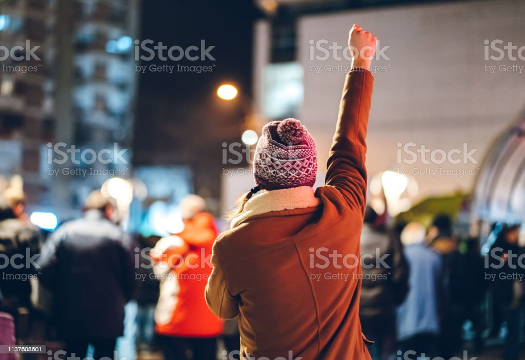 Freedom fighter Angry male protestor with a whistleblower Adult Stock Photo