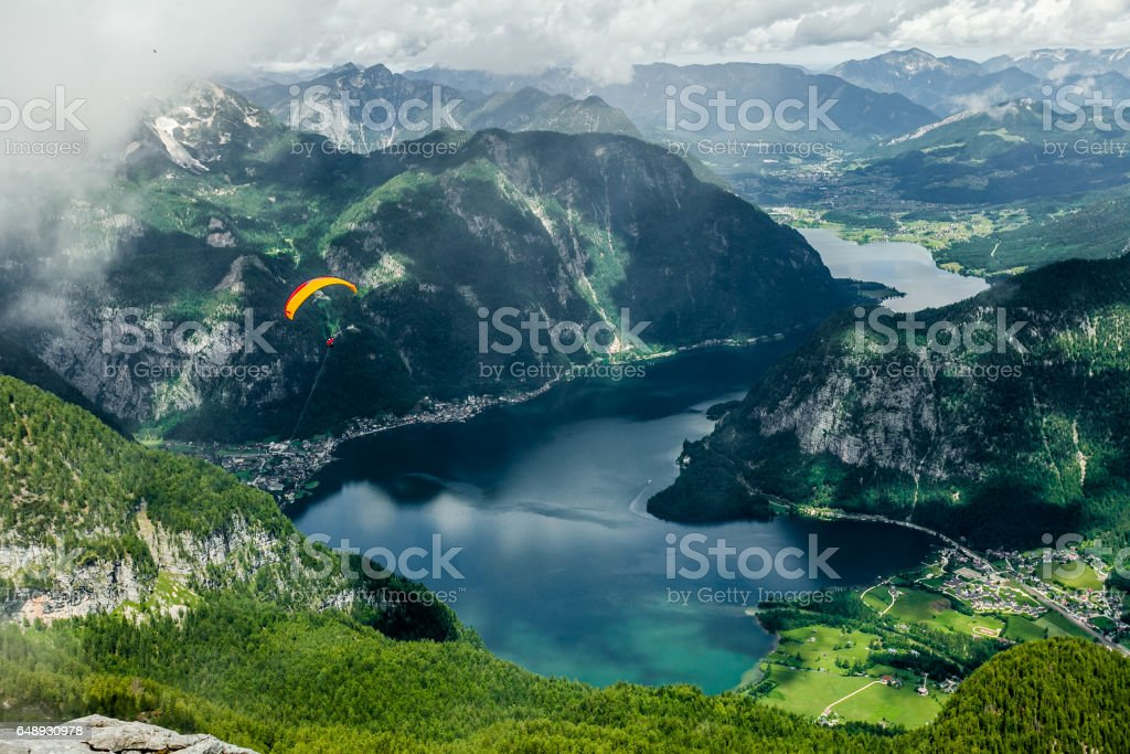 Freedom Flight. With a parachute over mountains and lakes. stock photo