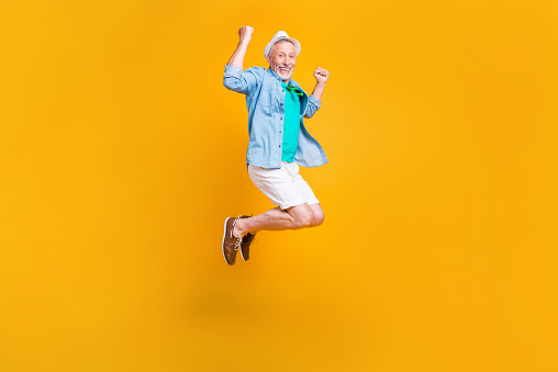 istock Freedom fly happiness hipster white jeans shorts stylish modern green outfit concept. Full length size photo portrait of joyful rejoicing handsome laughing cheerful guy jumping up isolated background 1009376050