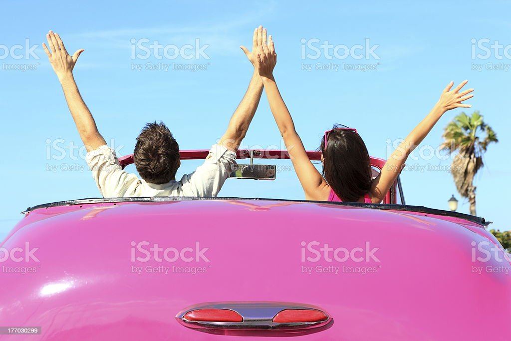 Freedom - happy free couple in car stock photo