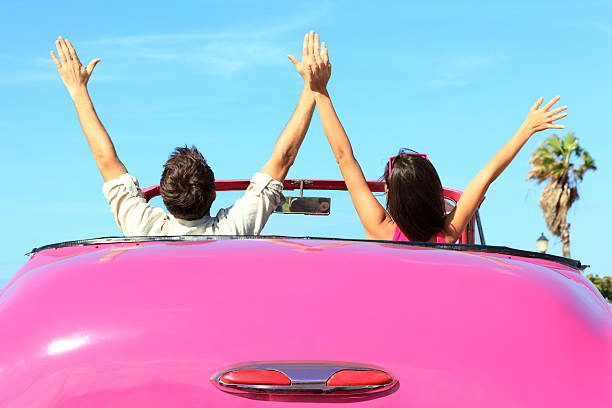 freedom - happy free couple in car - asian travel in car stock photos and pictures