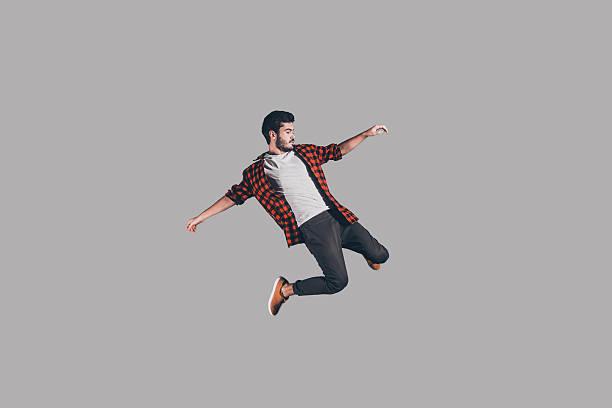 freedom in every move. - levitazione foto e immagini stock