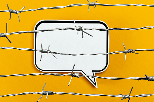 Barbed wire on the speech balloon.