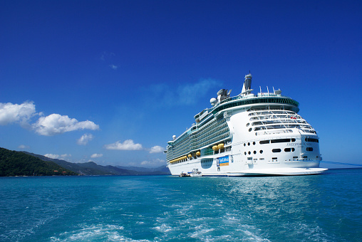 Labadee, Haiti - October 12, 2009:  Royal Caribbean Cruises, cruise ship Freedom of the seas anchored in Labadee. Labadee is a port located on the northern coast of Haiti. It is a private resort leased to Royal Caribbean Cruises.