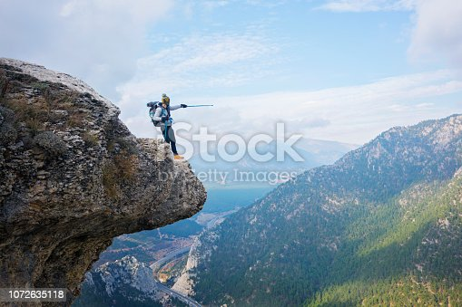 istock Freedom on the top of the mountain peak. 1072635118