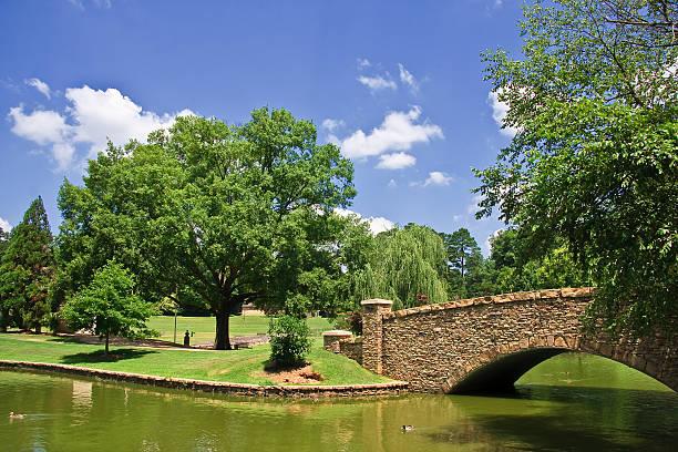 Freedom Park Bridge, green river with grassy hills