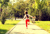 Girl with arms outstretched running on park, Running with sunset,