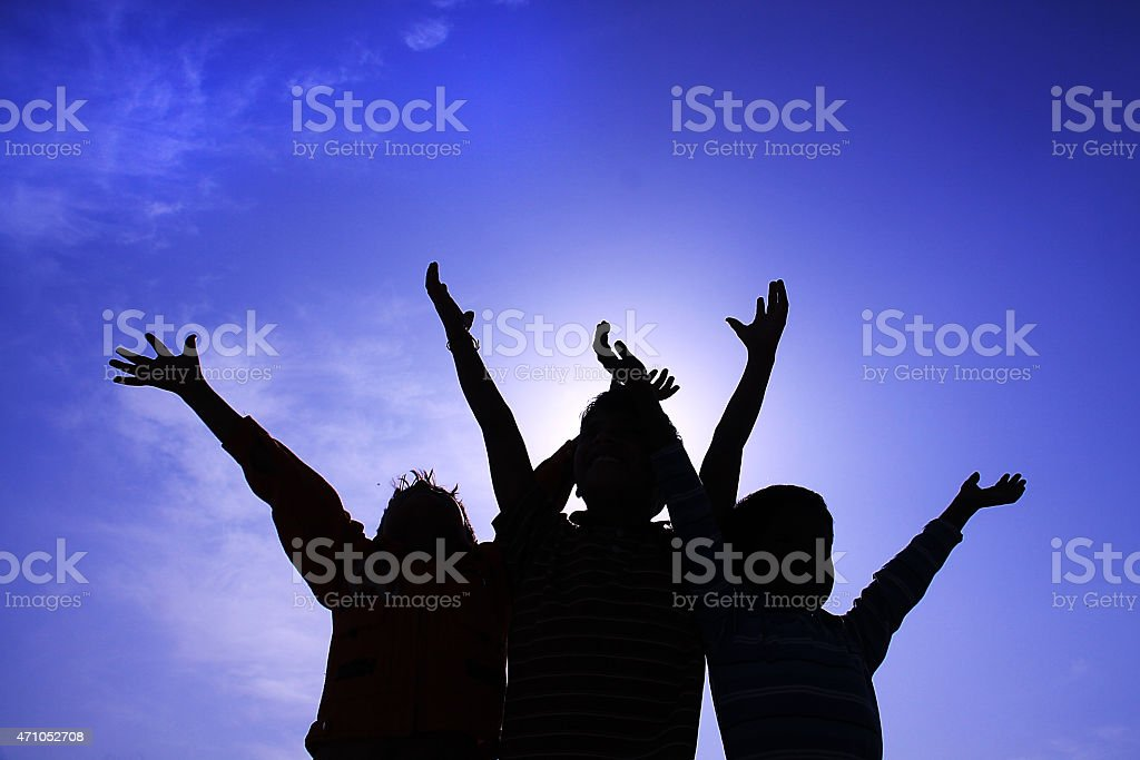 Freedom silhouette of three young boys stock photo