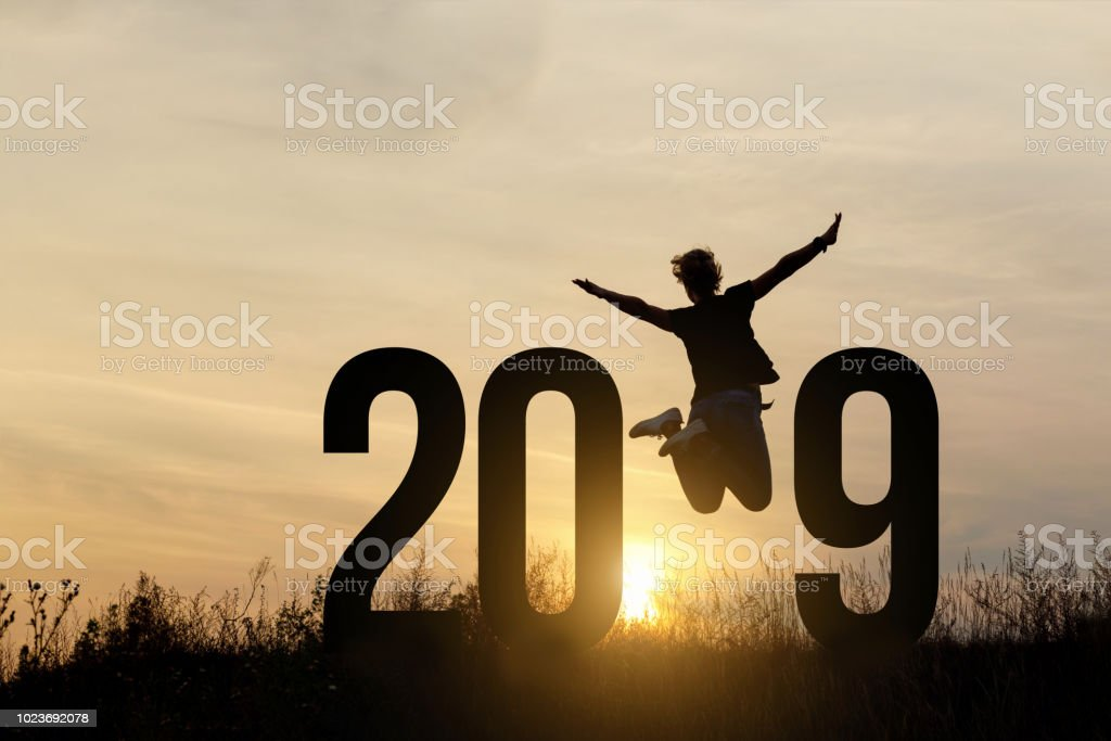 Freedom Silhouette woman and 2019 . stock photo