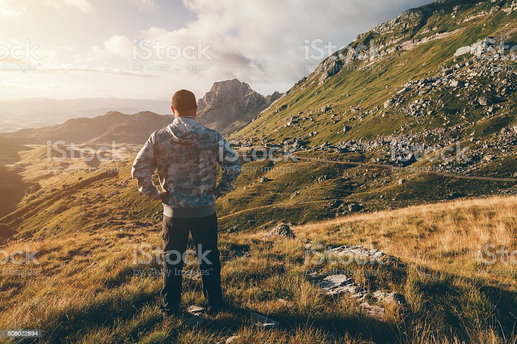 Freedom, strenght, life. Man on top of the mountain. stock photo