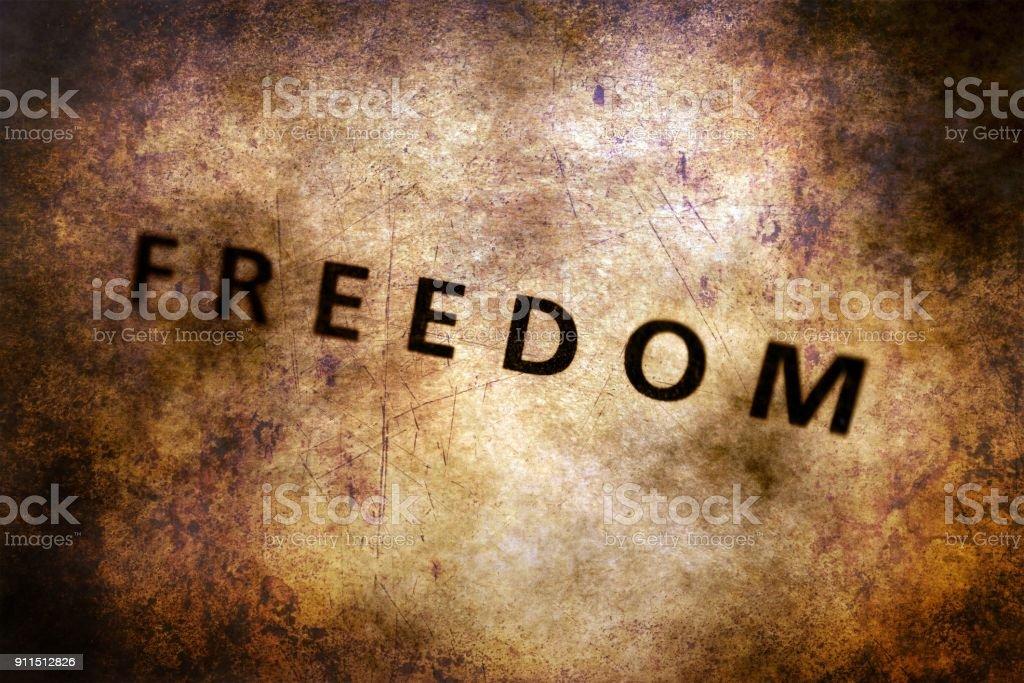 Freedom text on grunge background stock photo