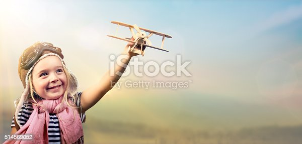 Joyful Girl Playing With Airplane Against The Sky - Vintage Effect