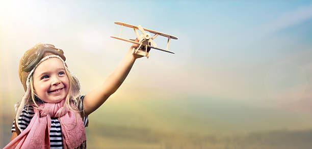 freedom to dream - kid with airplane - pilot stock photos and pictures