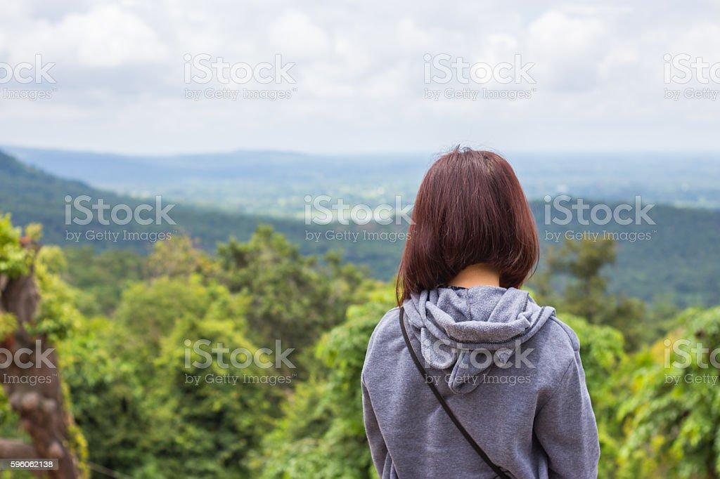 Freedom traveler woman standing enjoying a beautiful nature. royalty-free stock photo