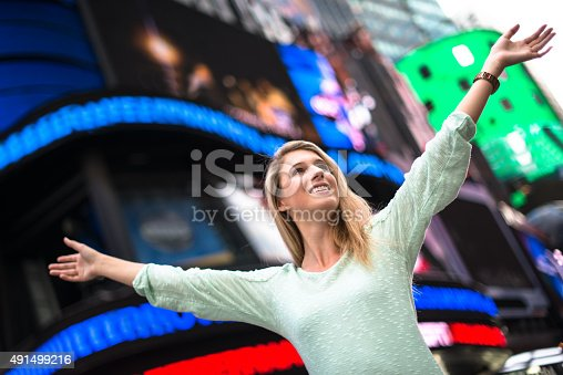 654490824 istock photo Freedom woman on times square - NYC 491499216