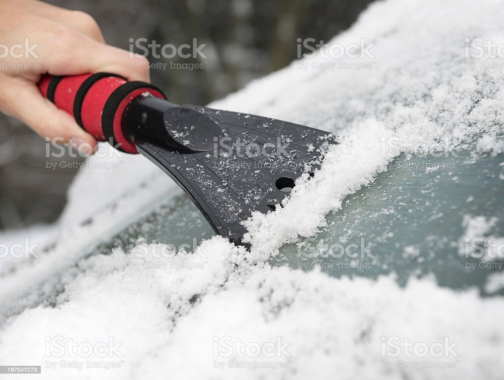 Freeing the Windshield from Ice stock photo
