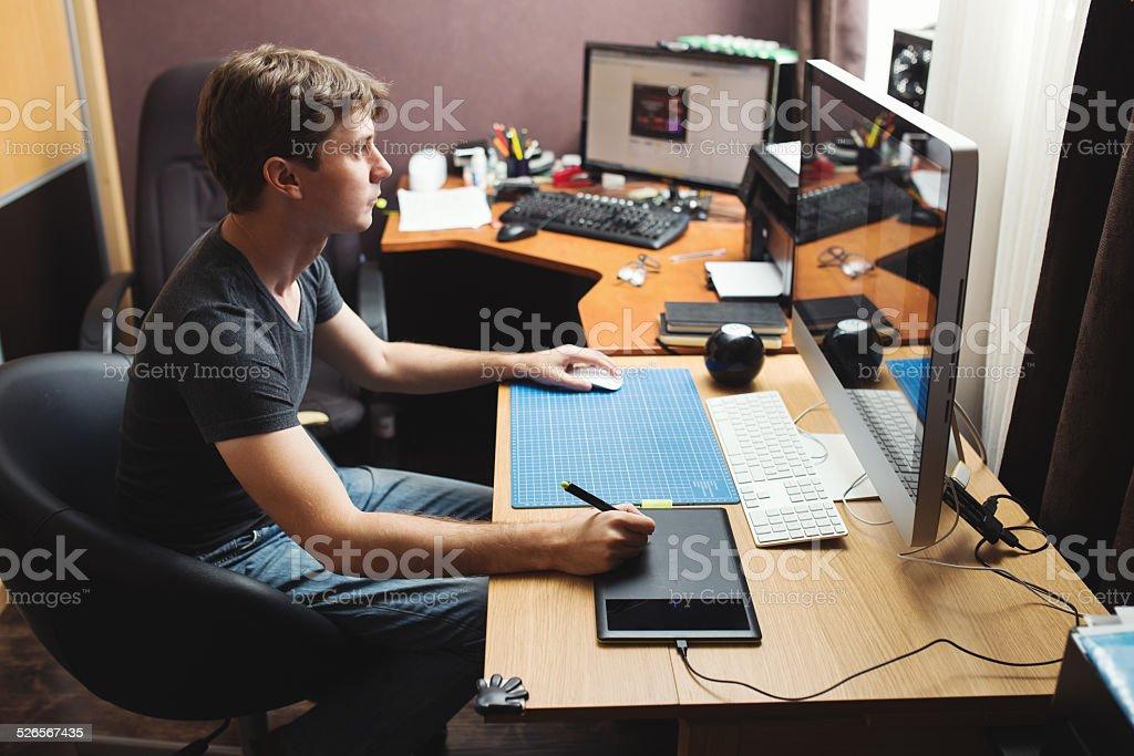 Freelance developer or designer working at home stock photo