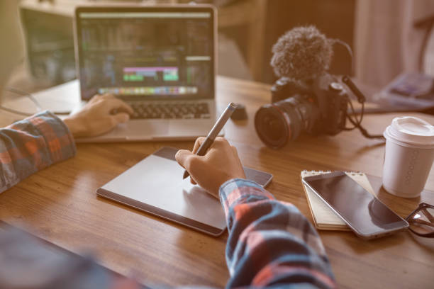 Freelance Editor working with footage video stock photo